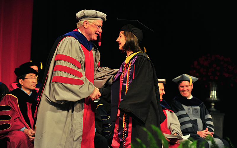 Female student accepts diploma