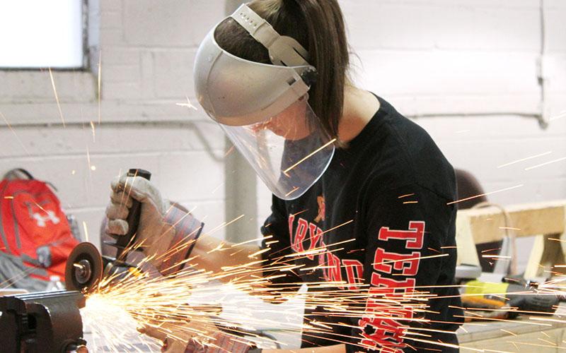 Concrete canoe team member welding