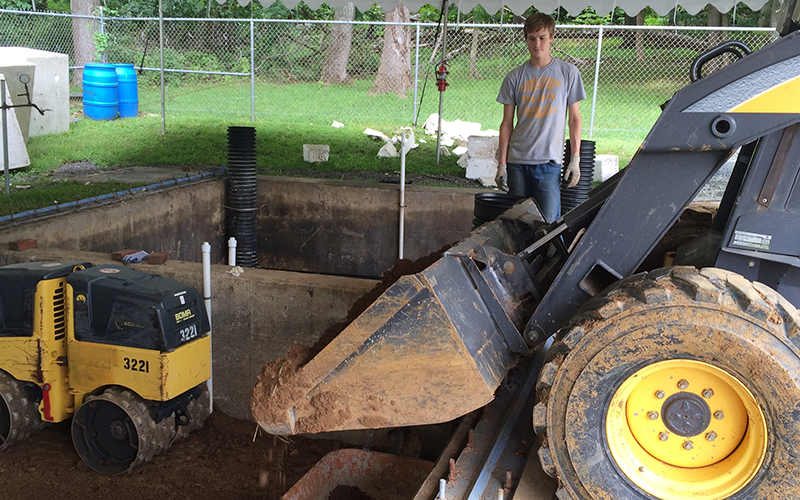 Student with construction equipment