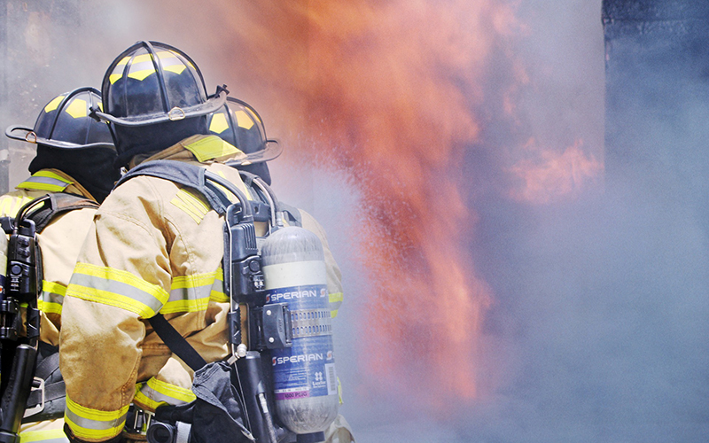 Stock image of firefighters in a disaster scenario