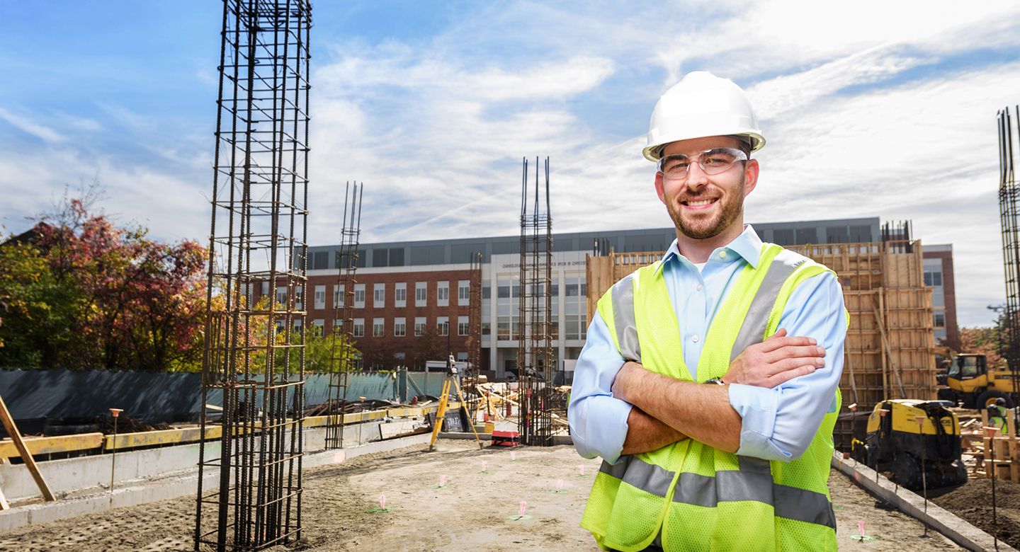 Civil engineer stands at build site